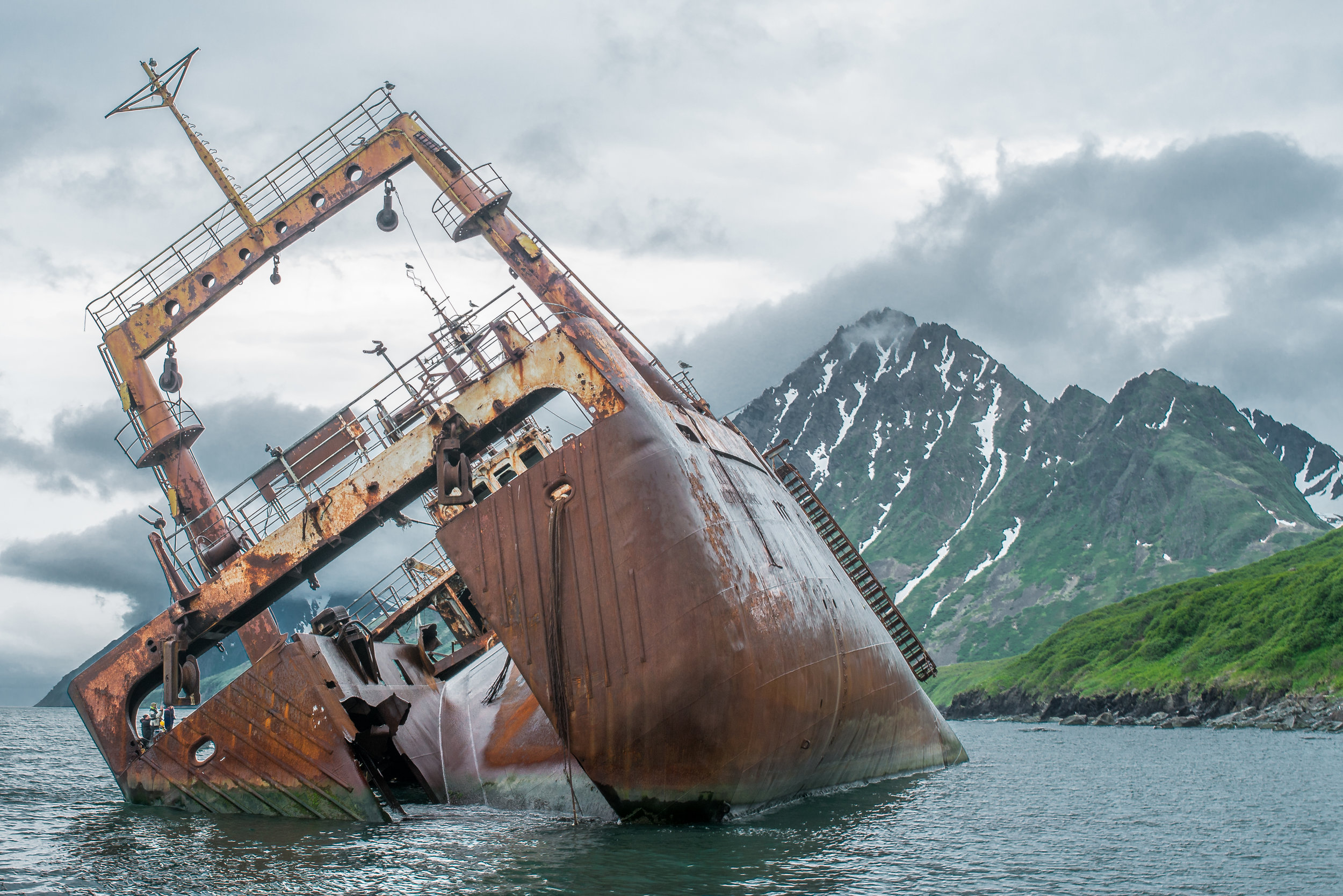 Featured Photo 54:Krechet Trawler Shipwrecked in 1978 during a storm - Bhukta Lavrova, KAM (RU)  EQ: D7200, 35mm f/1.4  Taken: 7-3-2017 at 16:04   Settings: 53mm eqv, 1/60s, f/11, ISO200, 1/3EV  Conditions: overcast
