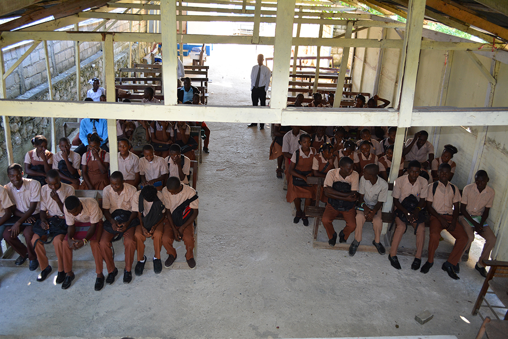 Students gather at St. Etienne's open-air school house which doubles as a worship space.