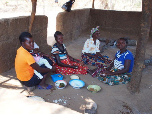 A group of women in the kitchen of the mother care shelter at Ndaiwala Health Center. Because of the long distances they must travel, women come to the clinic a week or two before their delivery date so they can receive a safe delivery of their new baby.