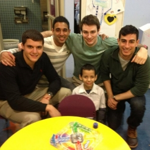 FIJI brothers spending some time with their B+ hero as part of their work with the Andrew McDonough B+ Foundation.