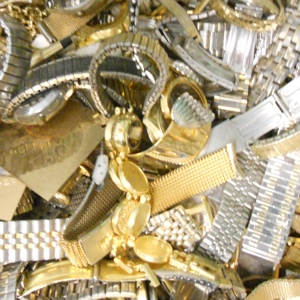 Photo of gold-plated jewelry scrap, including watch bands and cases, that Specialty Metals has recycled and refined for our customers.
