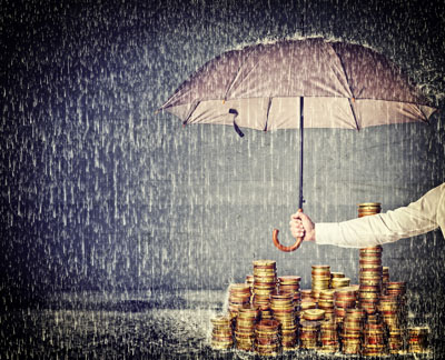 Image of gold under an umbrella on a riany day for Gold Refiners blog post titled Gold, Your Steady Friend. Credit: tiero/istock
