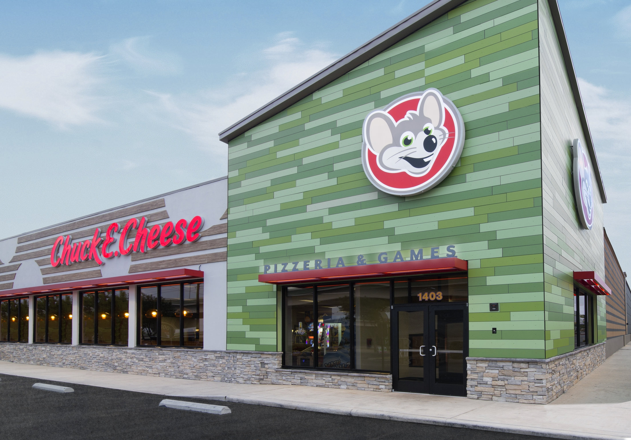 Chuck E. Cheese  new identity & storefront