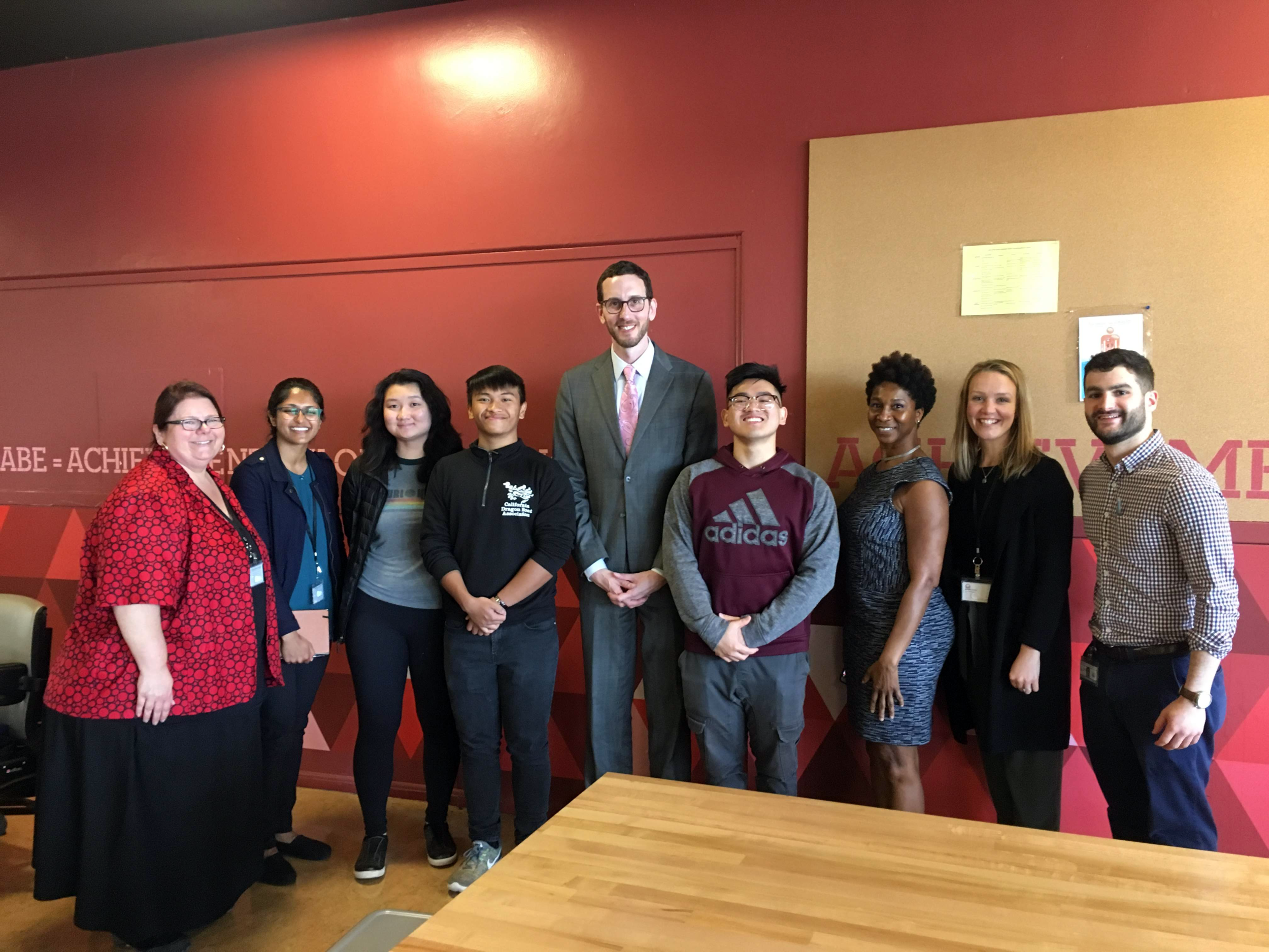 California State Senator Scott Wiener, center, joins Lincoln High School students for lunch, along with Student Nutrition Services staff and Executive Director Jennifer LeBarre, left