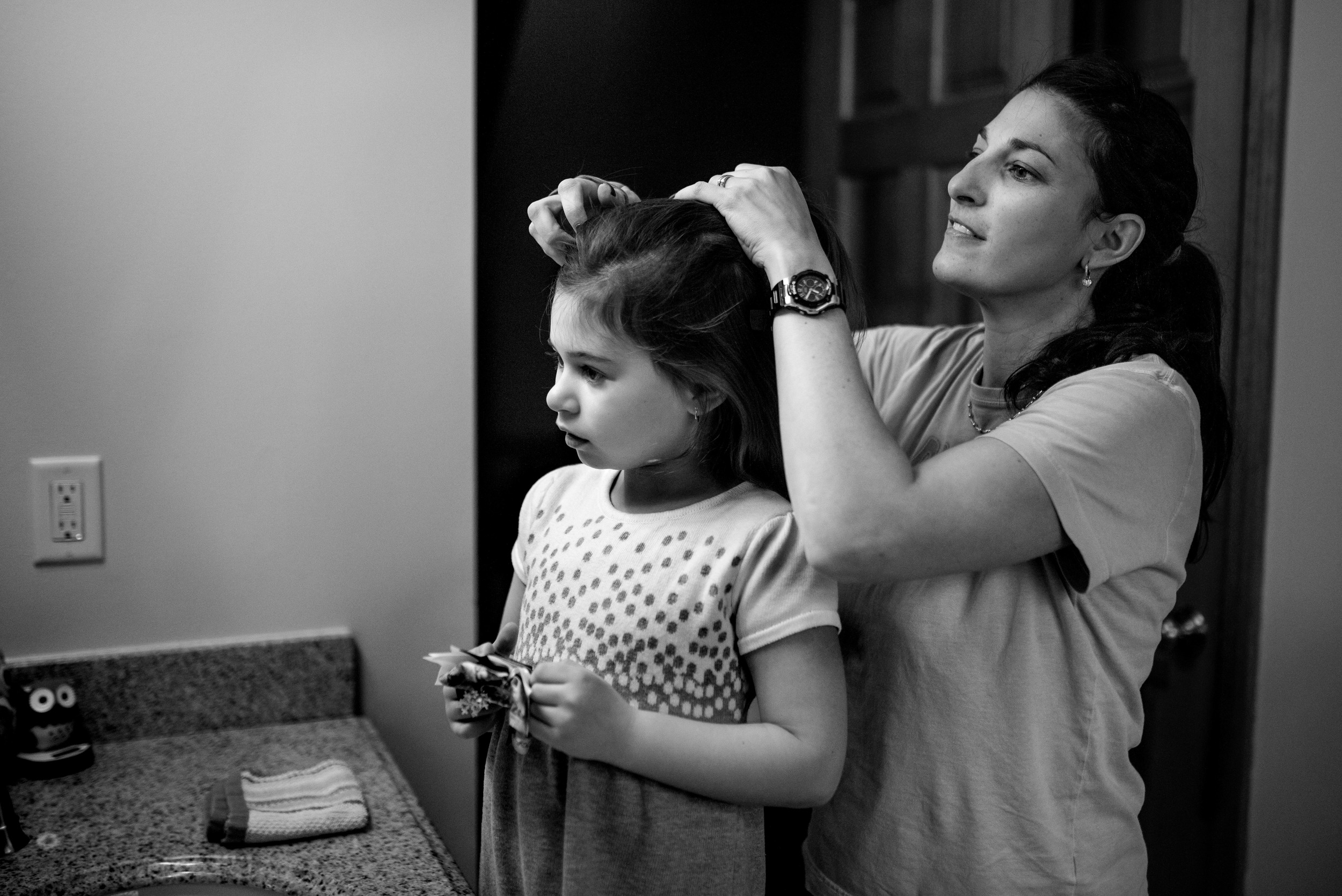 Mom Doing Daughter's Hair