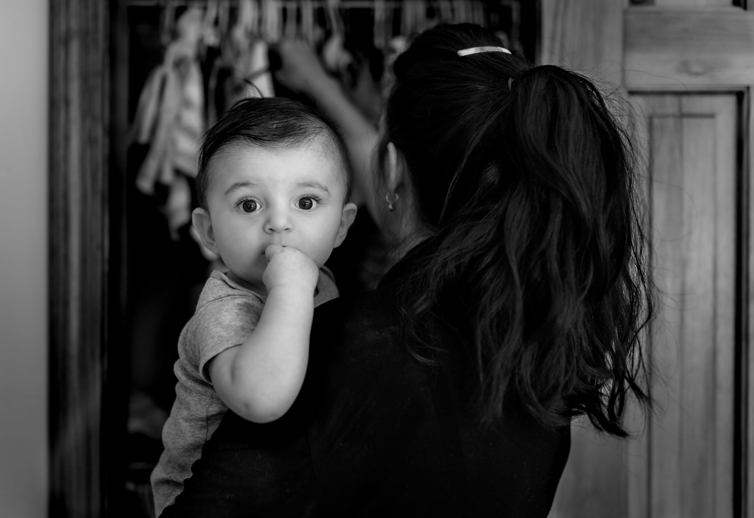 Mom Choosing Clothes For Baby