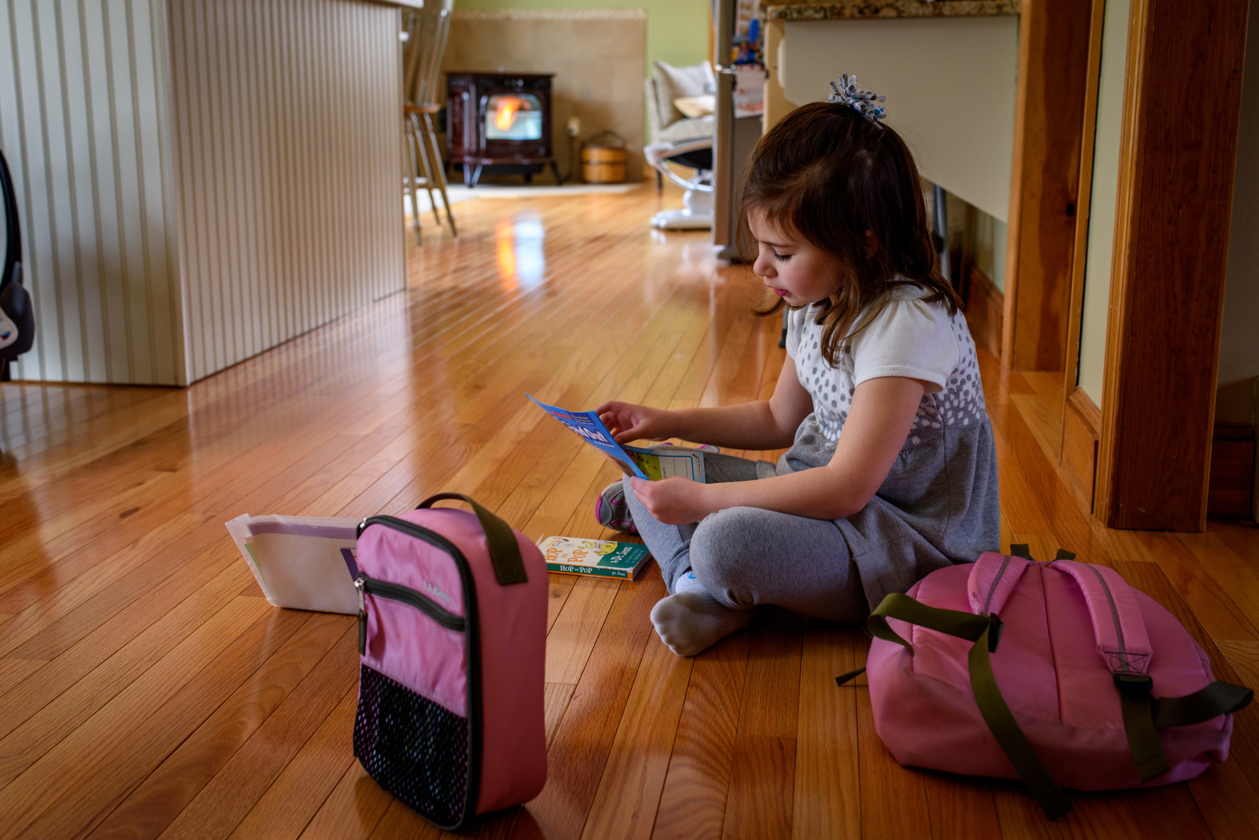 Daughter Opens Backpack After School