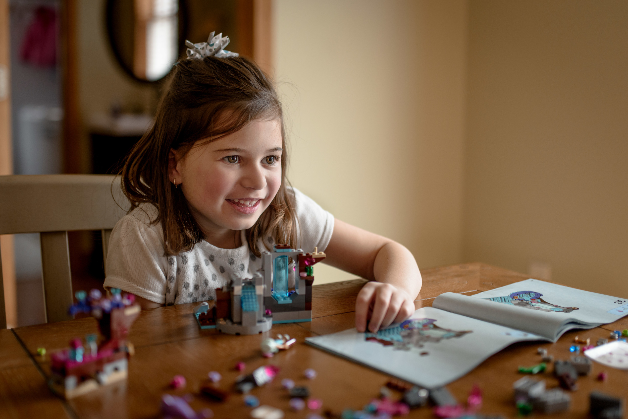 Daughter Happily Playing With Legos