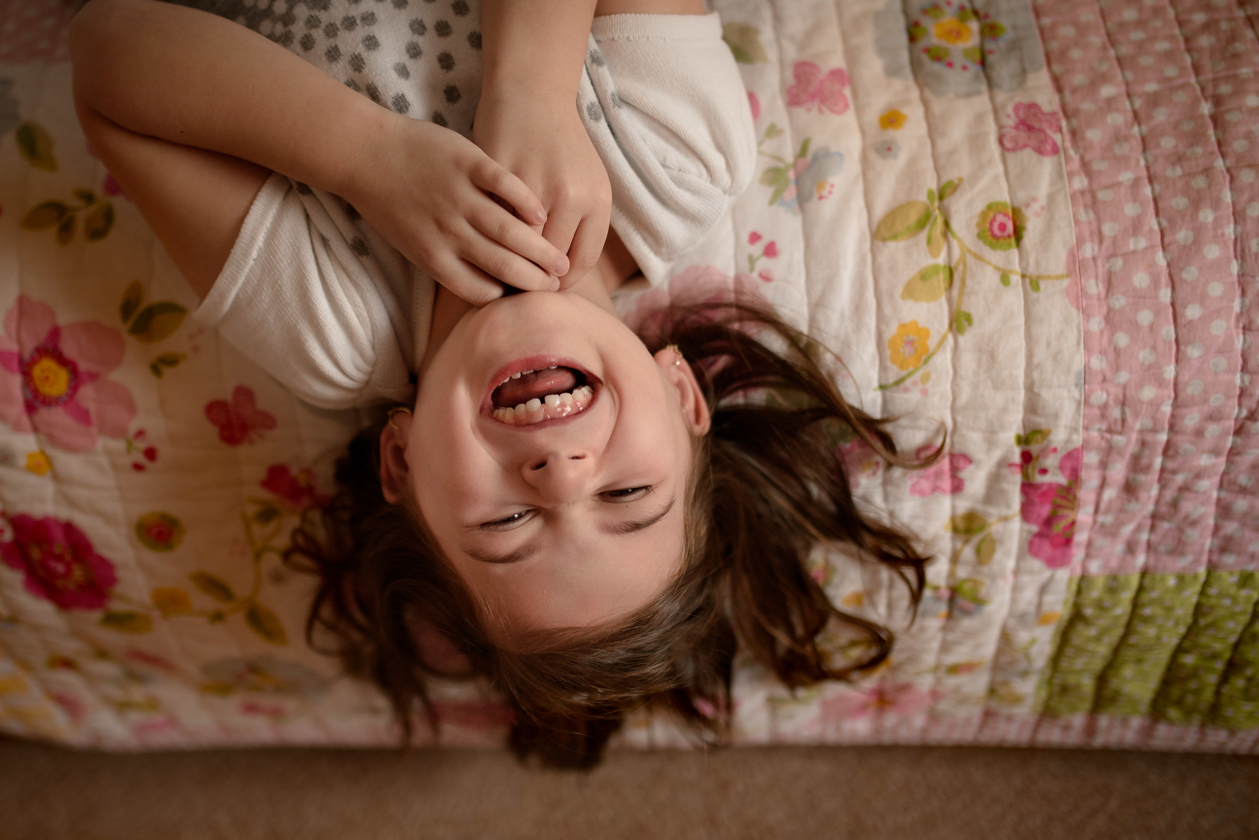 Daughter Laughing On Bed