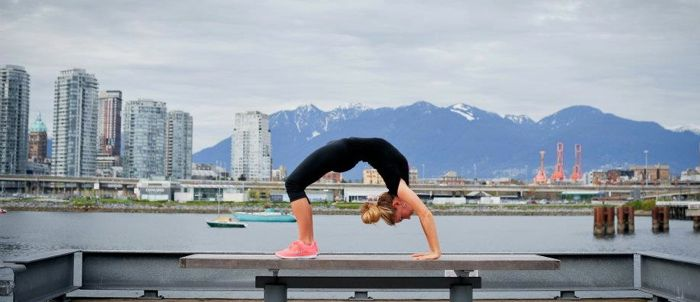 yoga-bend on bench water and city vancouver.jpg