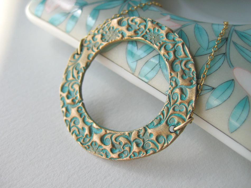 Handmade Bronze Eternity Pendant with Turquoise Patina Necklace.jpg