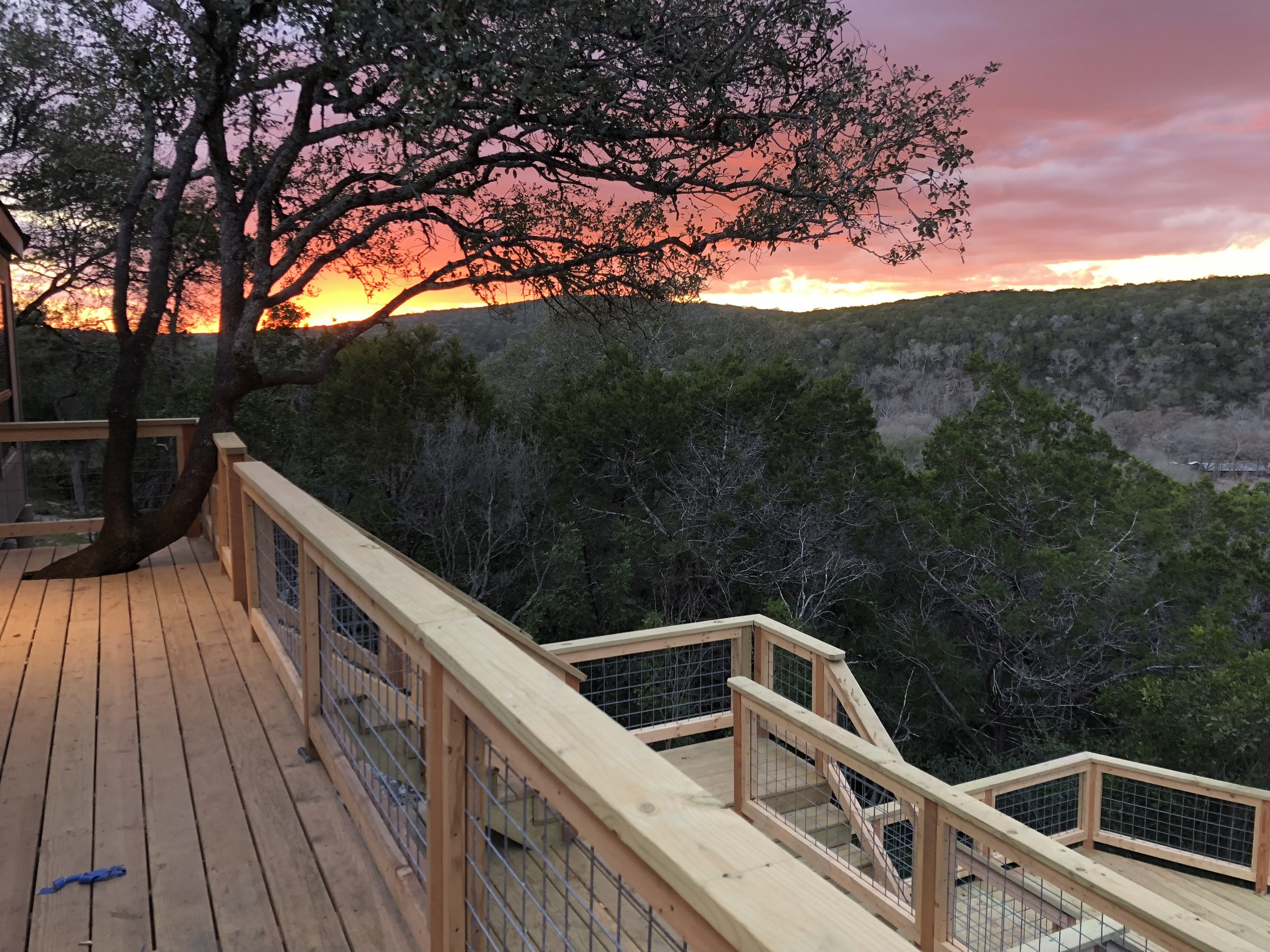 Beautiful sunsets are common off the back deck…the deck has not been stained in this photo