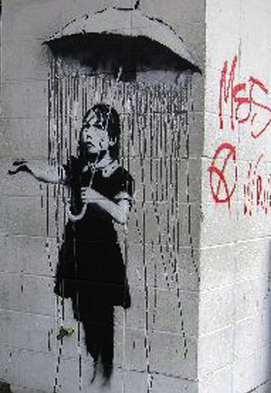 "Banksy, ""Umbrella Girl,"" 2008 on St. Claude Avenue at Kerlerec Street in Marigny"