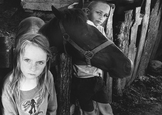Shelby Lee Arnold,  Children with Blind Horse, 2008 . Silver print