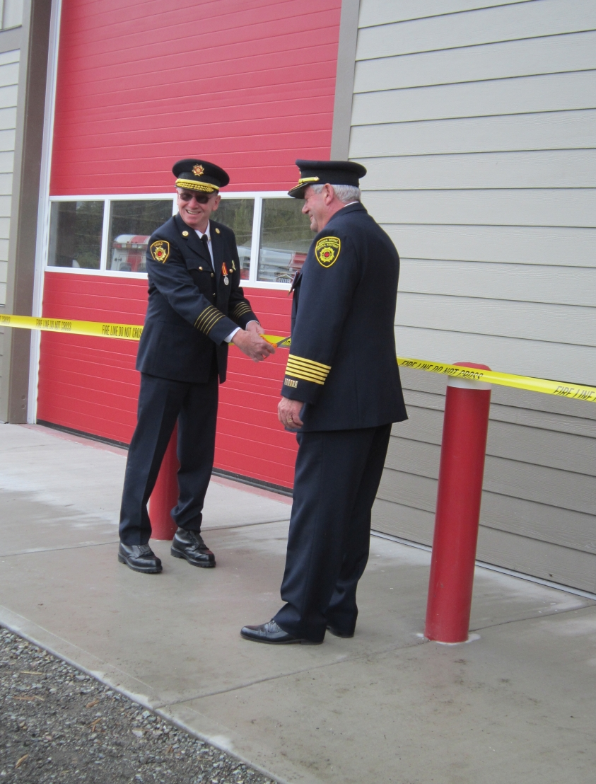 Assistant Fire Chief Larry Badry (left) and Regional Fire Chief Terry Swan, cutting the ribbon at the opening day ceremony in 2014.