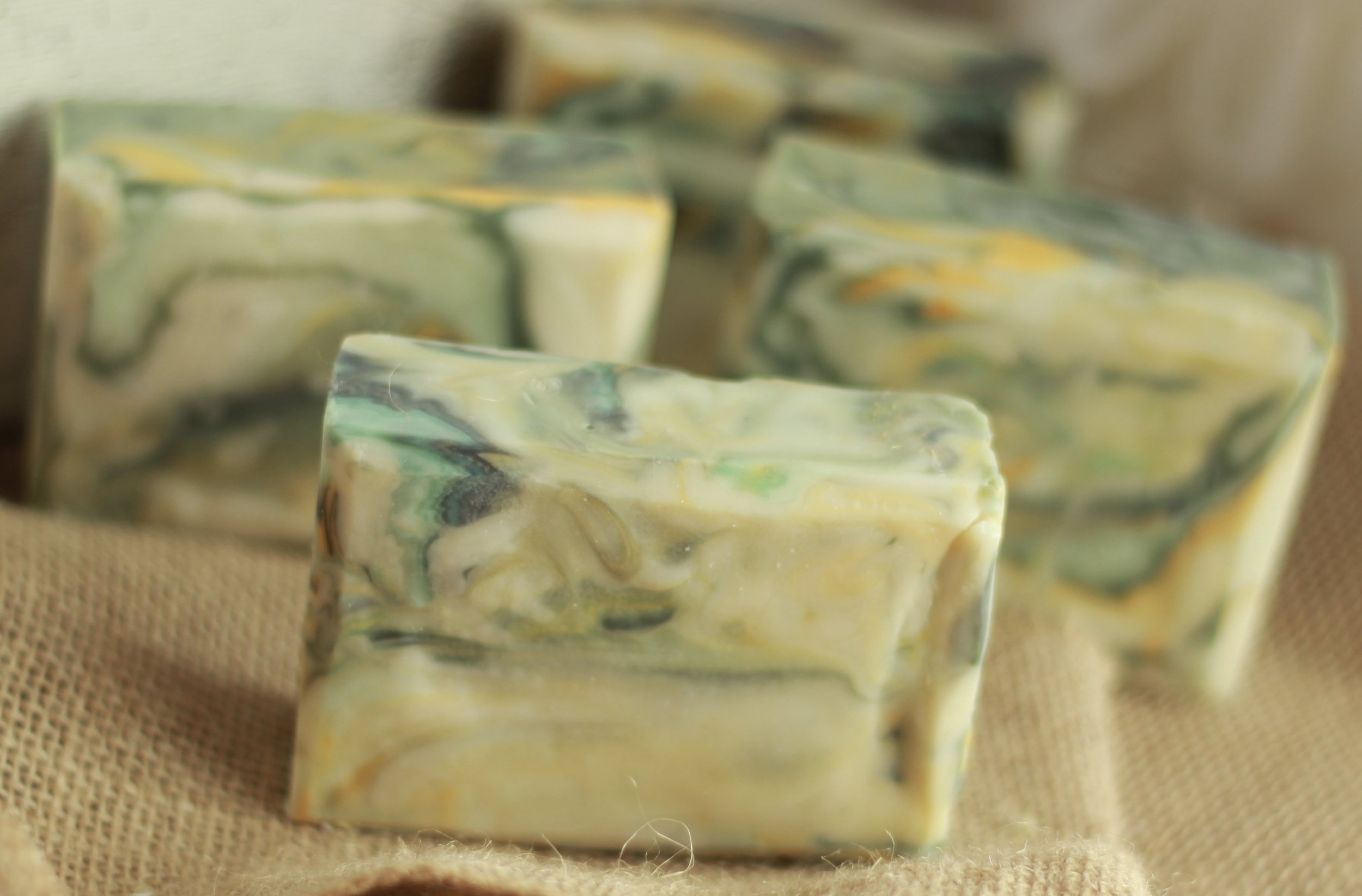 - Tea Tree Mint Loofah Soap. This soap is made with avocado, coconut, palm, and castor oils as well as green tea extract and essential oils.  Slices of a loofah sponge have been placed in the bottom half of each bar for exfoliation.
