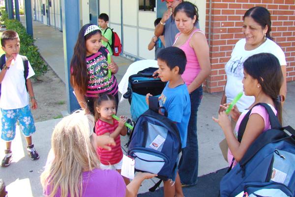 Delivering back packs at local schools