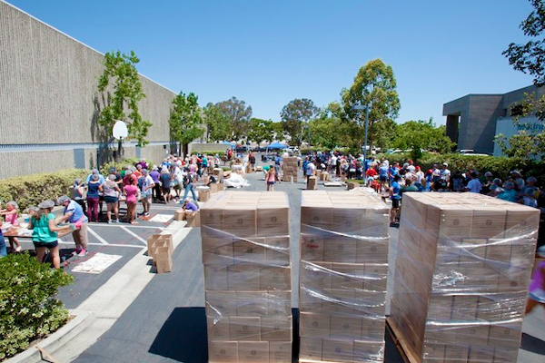 300 people packaging 80,000 meals!