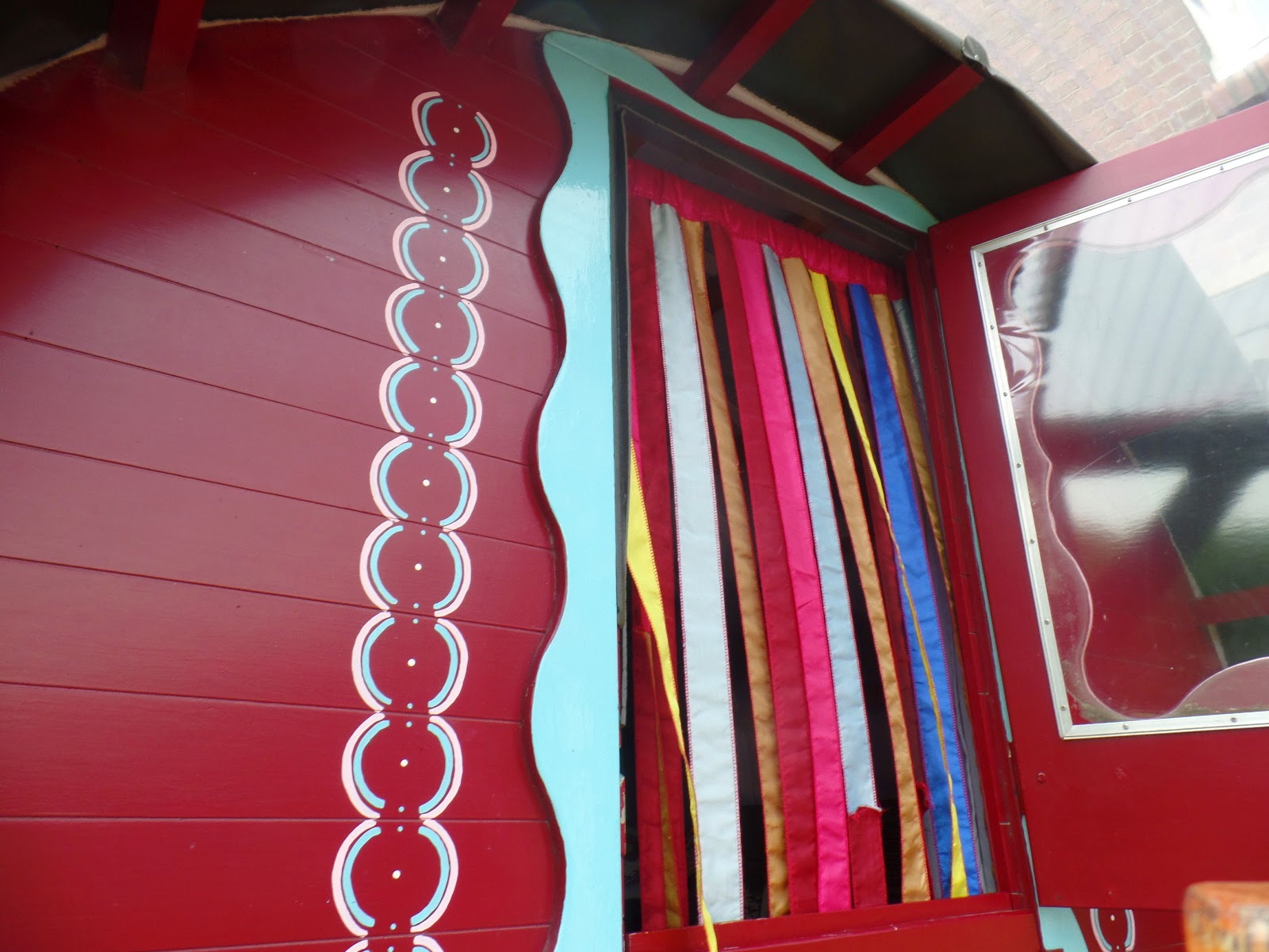 The front door to the caravan, with lovely strip curtains