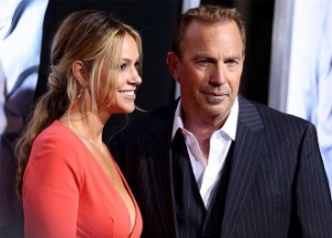 Costner and his wife at the red carpet premiere of his 2014 movie 3 Days To Kill.