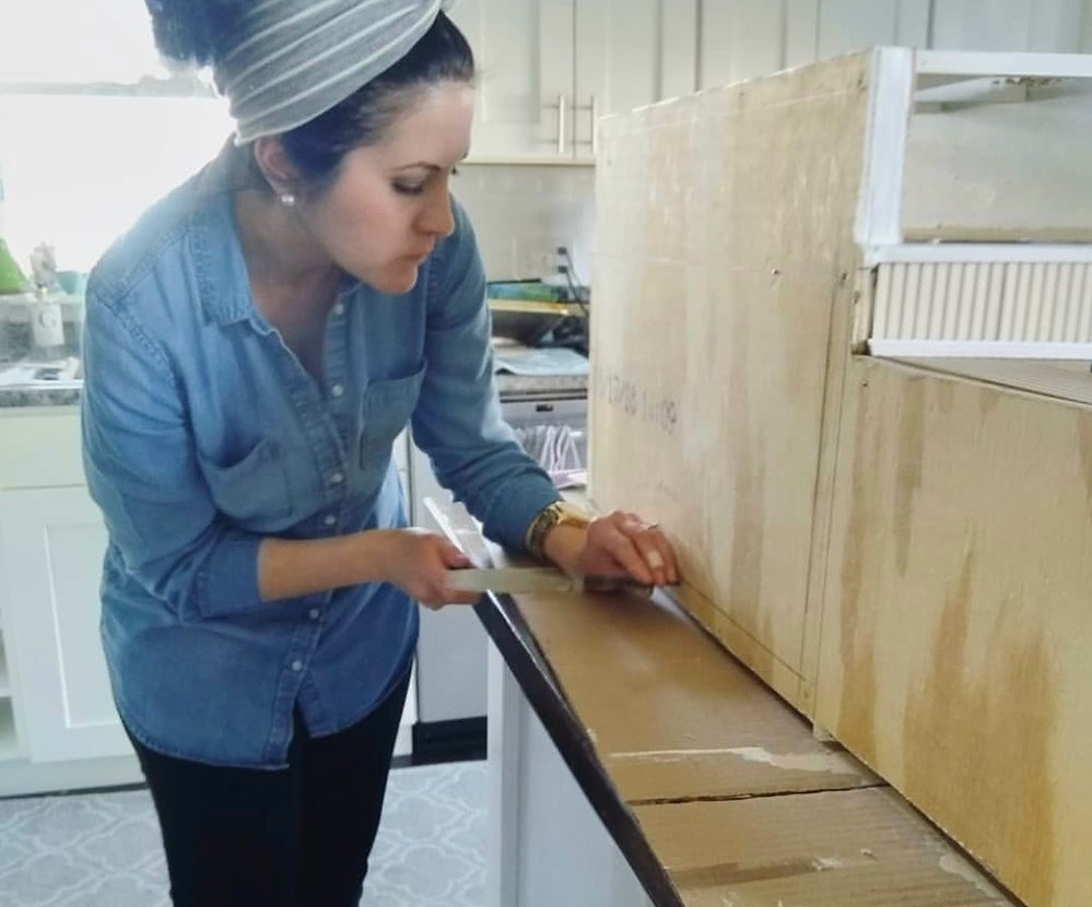 Carolyn working on a dollhouse