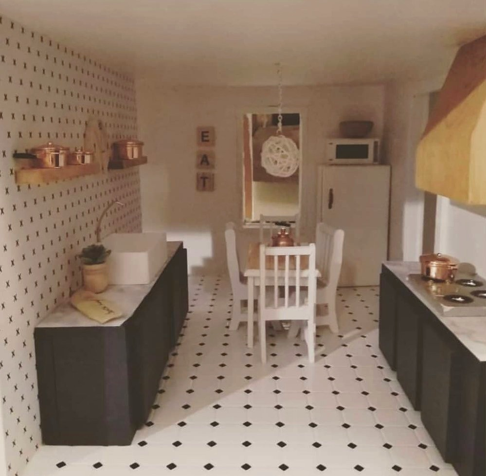 A dollhouse kitchen that Carolyn recently redesigned.
