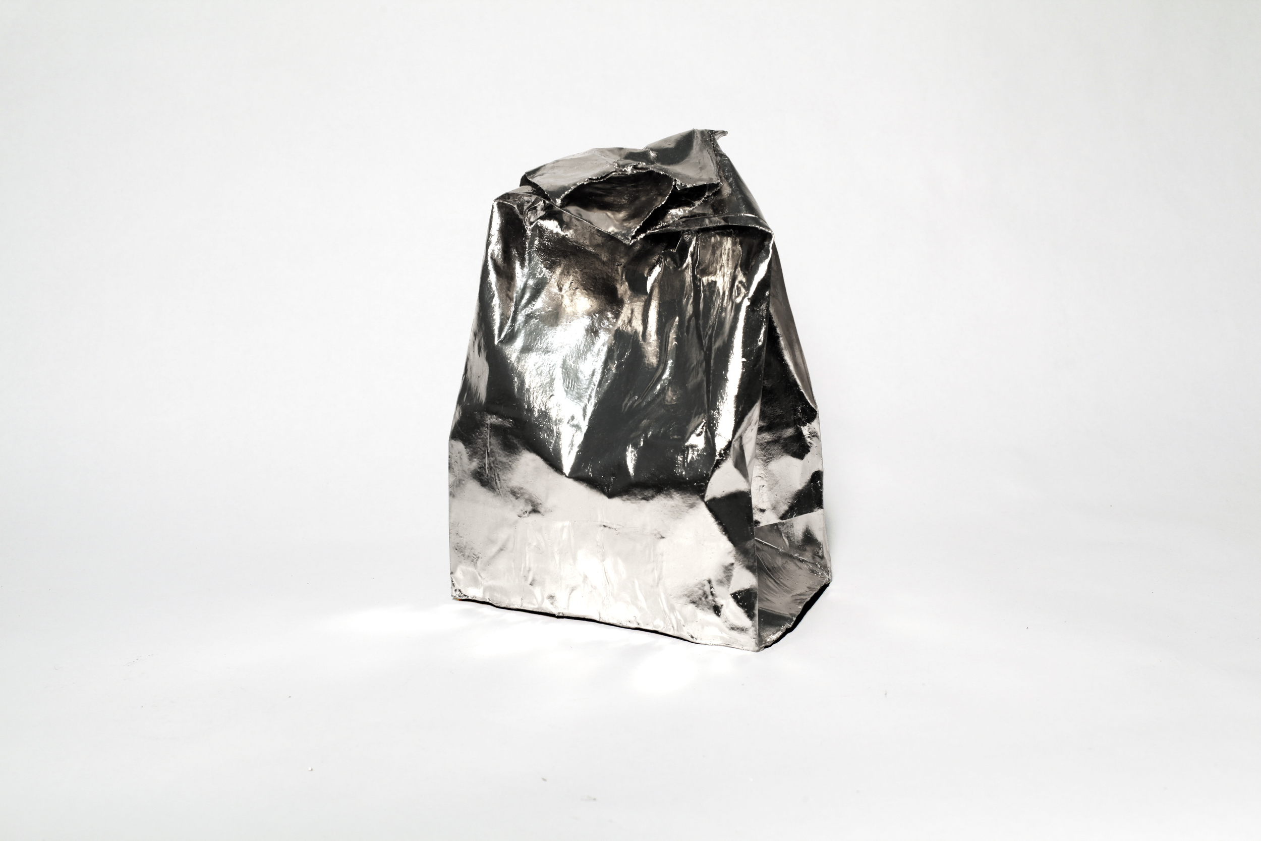Liisa Lounila:  The Best of Them All , 2012, palladium on brown paper bag, plaster and resin