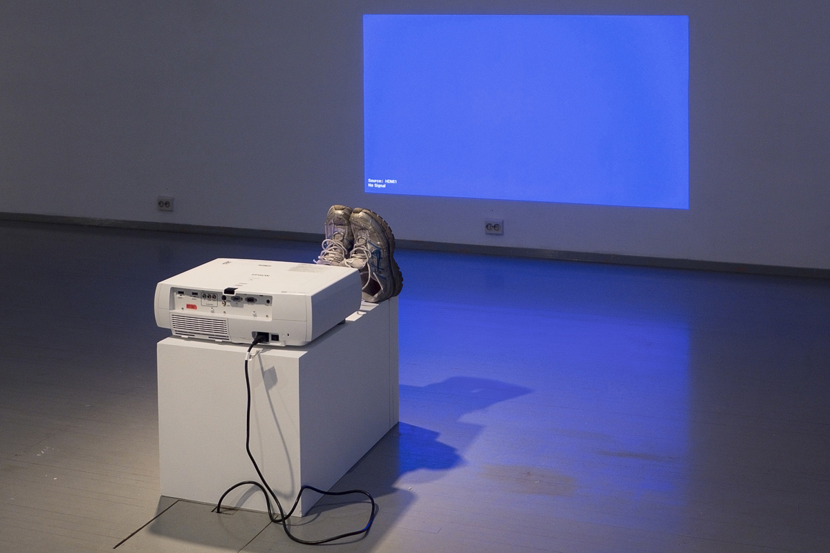 Nestori Syrjälä, Shoe Dryer, 2013. Sculpture: Epson EH-TW3200 projector, Nike running shoes, mud.