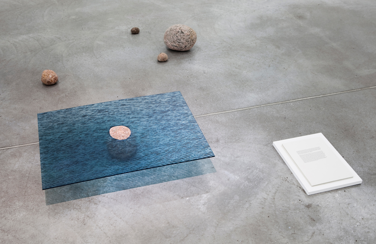 Noronkoski is intrigued by the demarcation between images, objects and written language. Land Ho!, 2013/2016. Uv print on acrylic, 75cm x 55cm, granite stone, text. Courtesy of the artist.