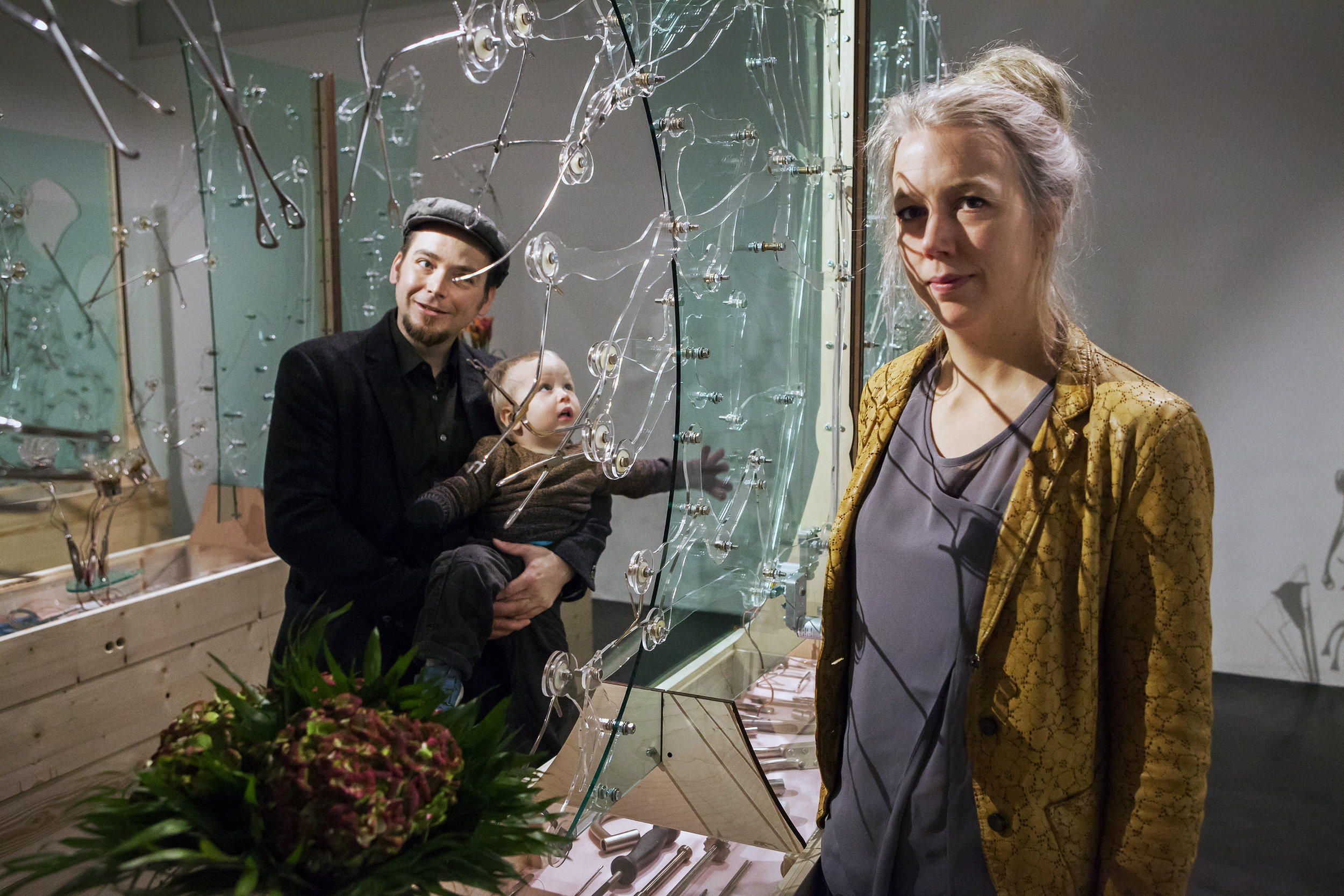Pekka and Teija Isorättyä with their son, Iisakki, standing inside Nature Morte installation at Kiasma Museum of Contemporary Art in 2017. Photo by Petri Virtanen.