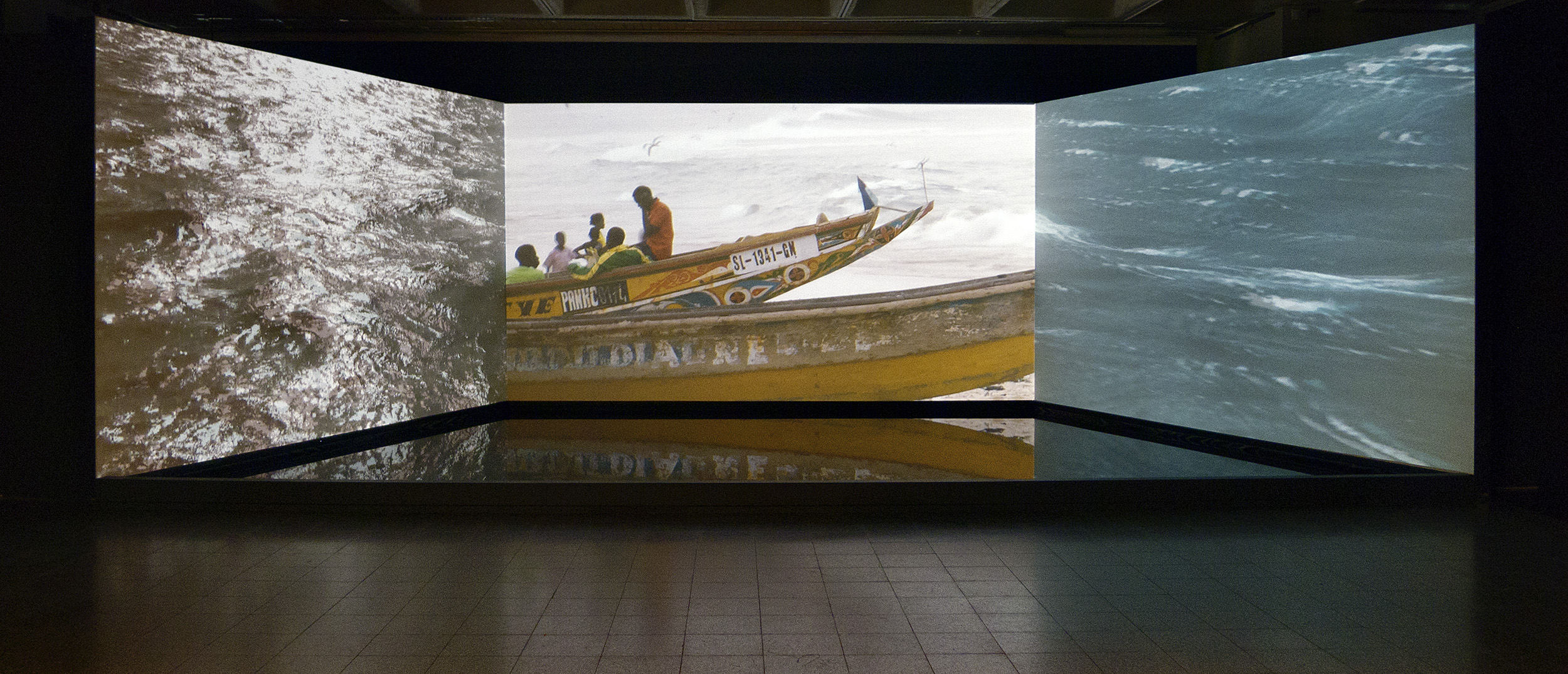 Rita Jokiranta,  Here, and Beyond , 2011. 3-channel video installation with a water basin. Installation view.