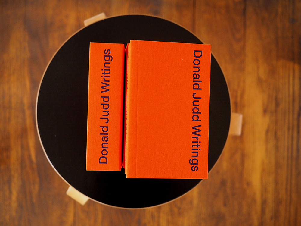 Donald Judd Writings  with Alvar Aalto stool 60 at Judd's 101 Spring Street residence (Photo by Flavin Judd)