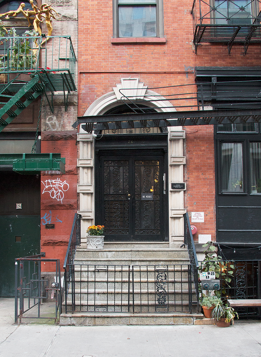 26 Bond St with its landmarked facade is one of the only townhouses left on the street. Our neighboring building's facade features the famous sculpture by artist Bruce Williams.