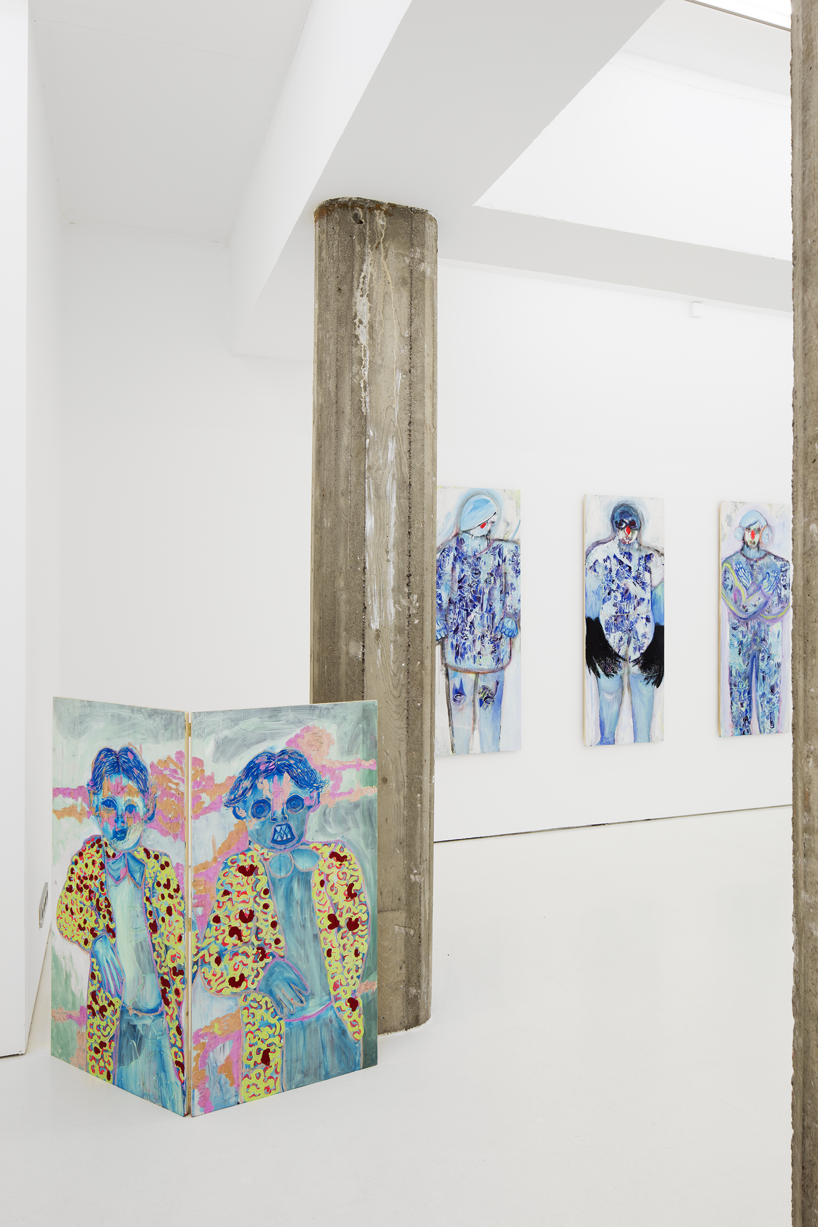 View to the exhibition  Roses, Black Birds and Witches  on Helsinki Contemporary in 2019. Works:  Little blue , Painting and carving on wood, height 120 cm width 120 cm, 2018, and  Witch 2 , Painting and carving on wood, height 160 cm width 60 cm, 2018. Photo: Jussi Tiainen.