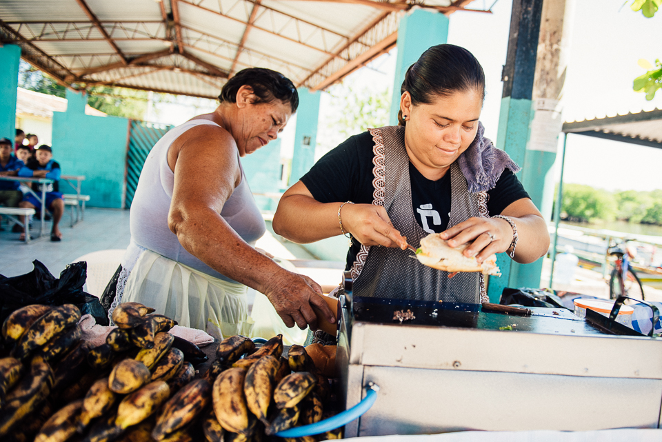 While men harvest coconuts from the islands surrounding Puerto Parada, the women make fresh grilled sandwiches to feed them upon their return. Plantains stacked high are a tasty snack and common culinary ingredient in El Salvador.