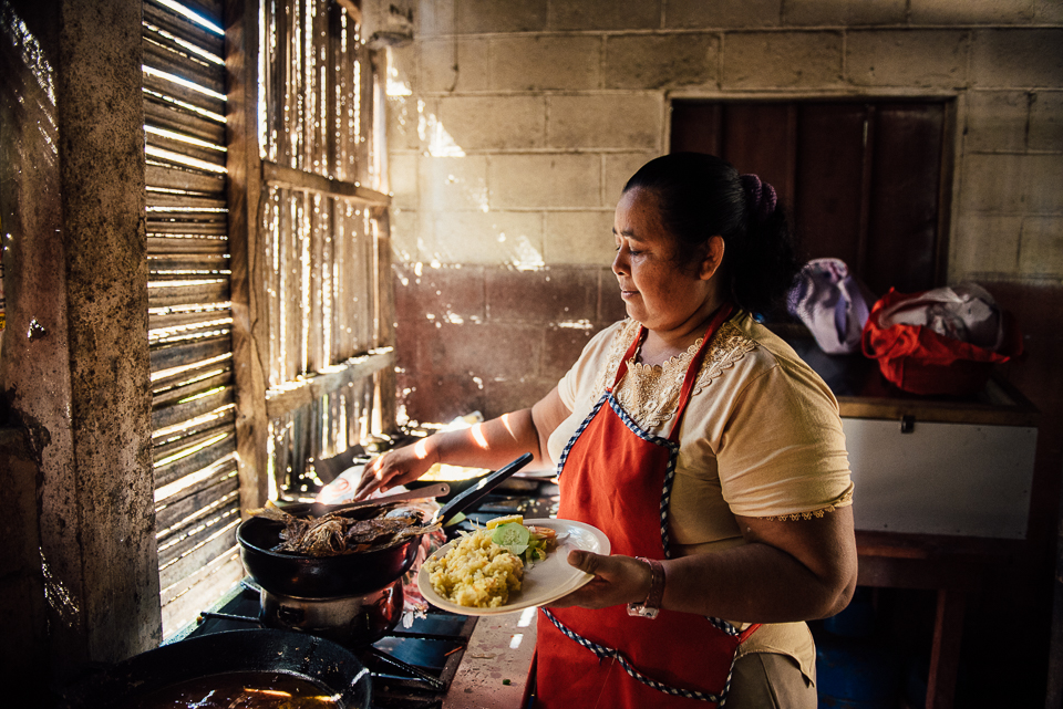 I asked to watch this local woman prepare our lunch of fried fresh-caught fish, rice, and salad. It was a simple set up and utterly delicious.