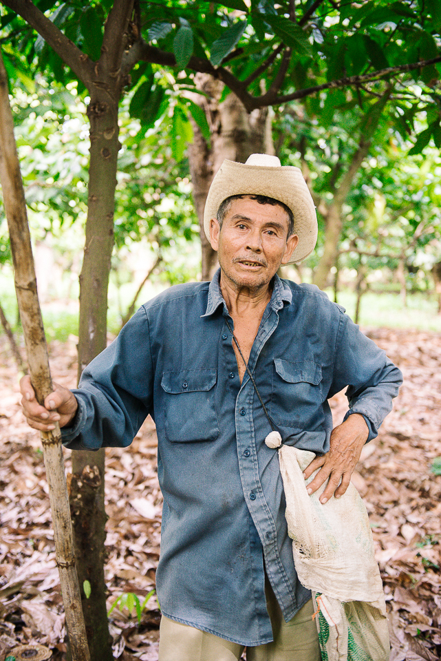 I asked to split from the group to meet some of the cacao farmers, so we sped off on an ATV into the cacao groves to photograph them at work.