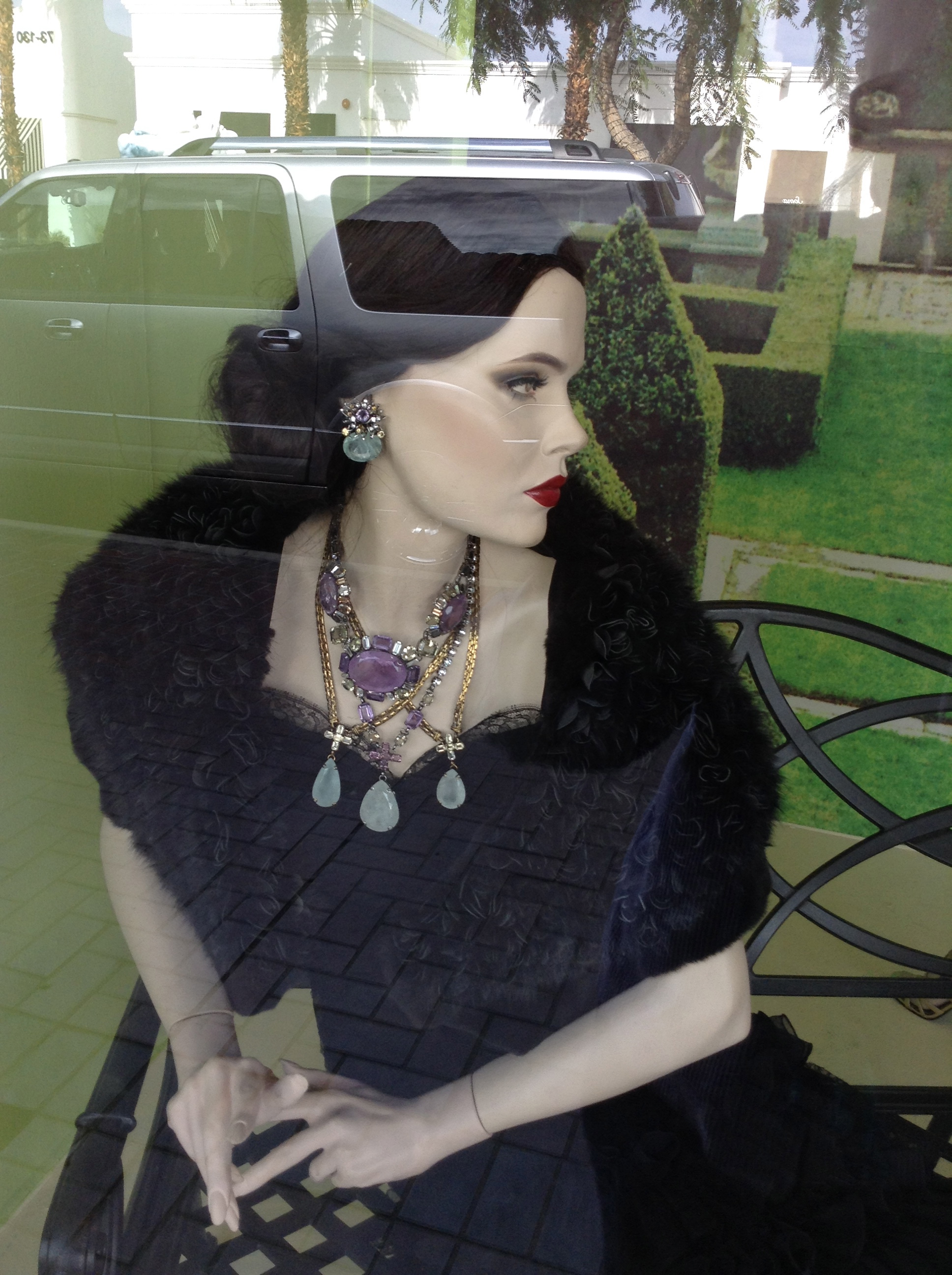 Fabulous fashion and jewels on an elegant mannequin at Fe Zandi Haute Couture on El Paseo Drive in Palm Desert.