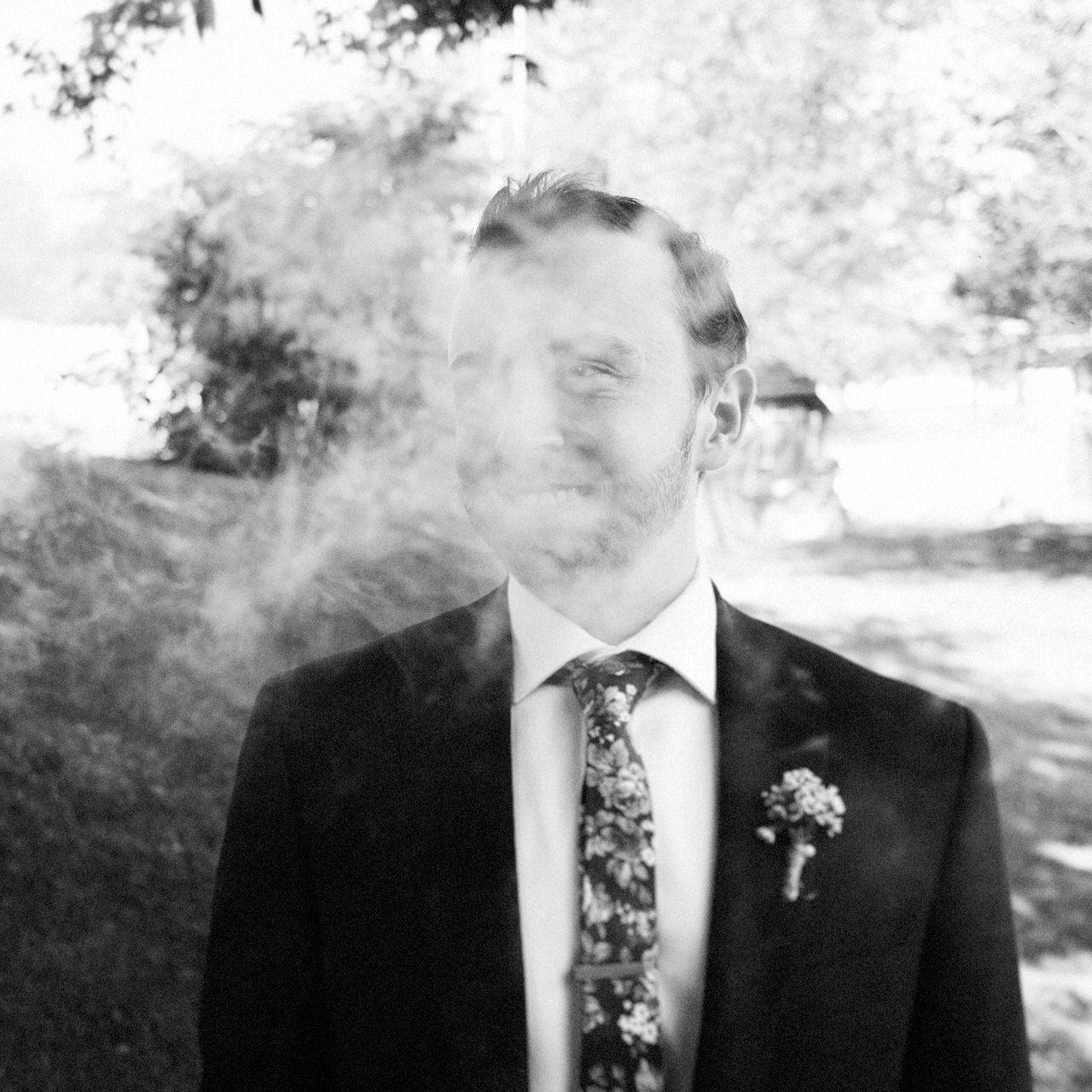 Hip groom smoking portrait.jpg