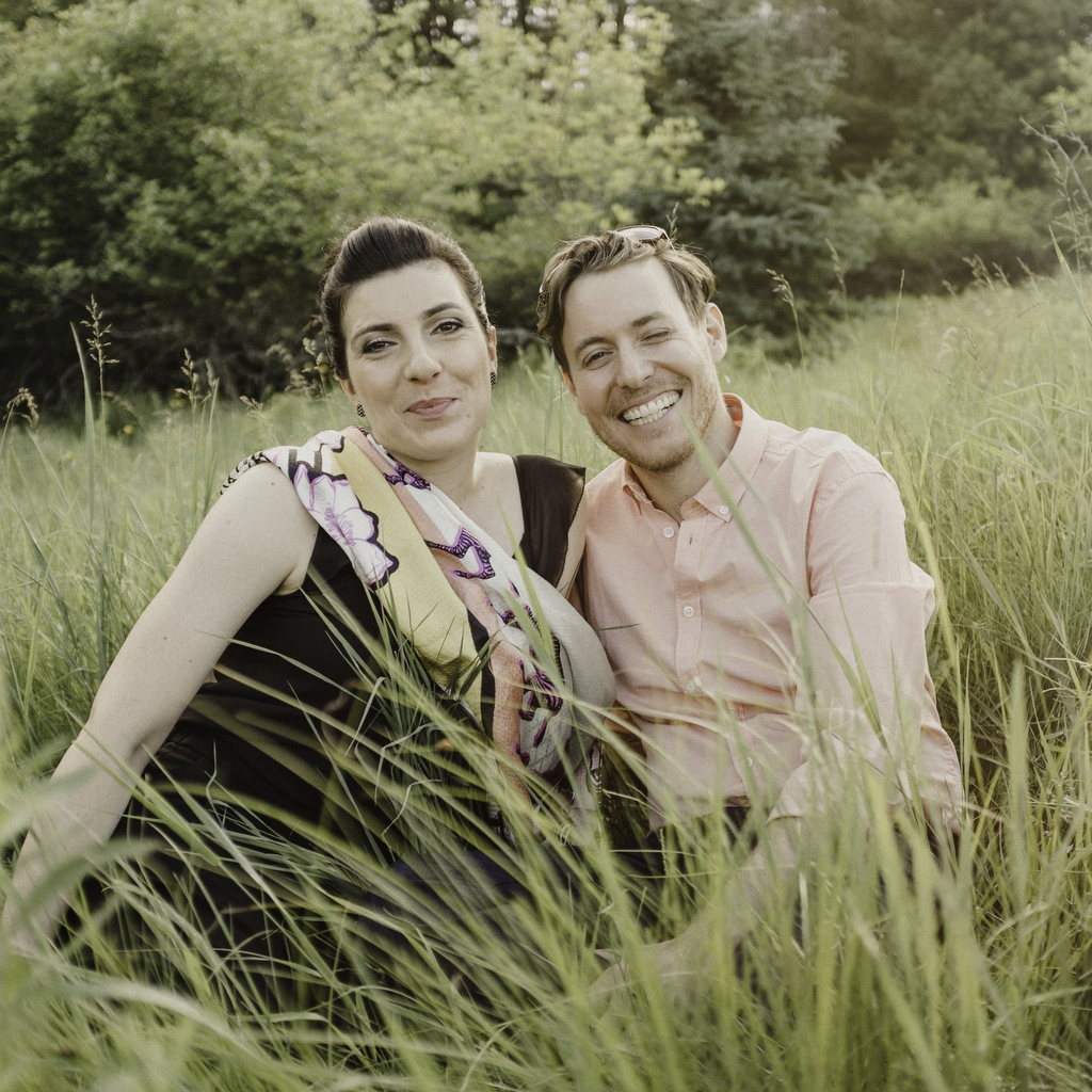 Engaged couple in field during their Wakefield Adventure Session.jpg