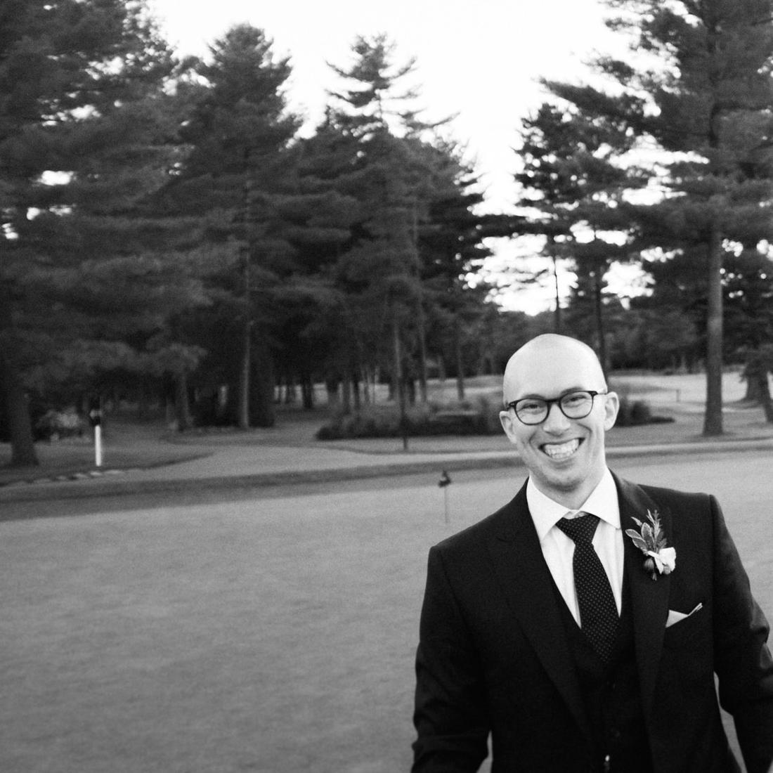 Swedish Groom wedding portrait at Golf Le Mirage, Montreal.jpg