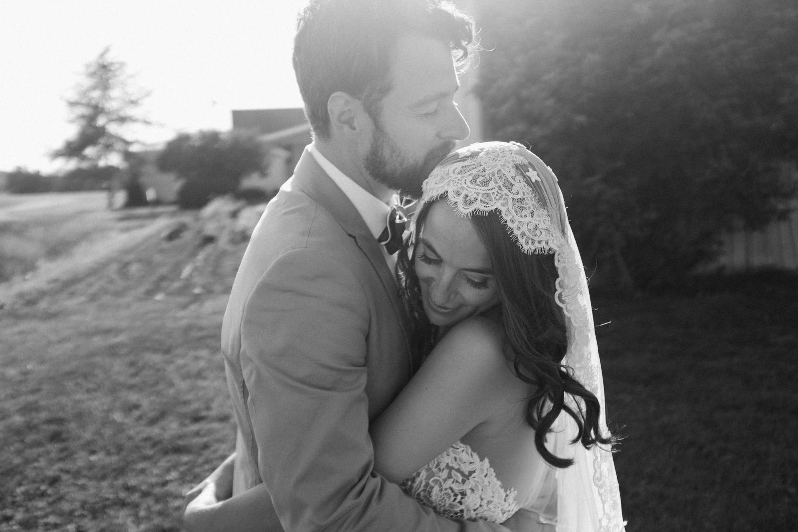 emotional bride and groom wedding portrait.jpg