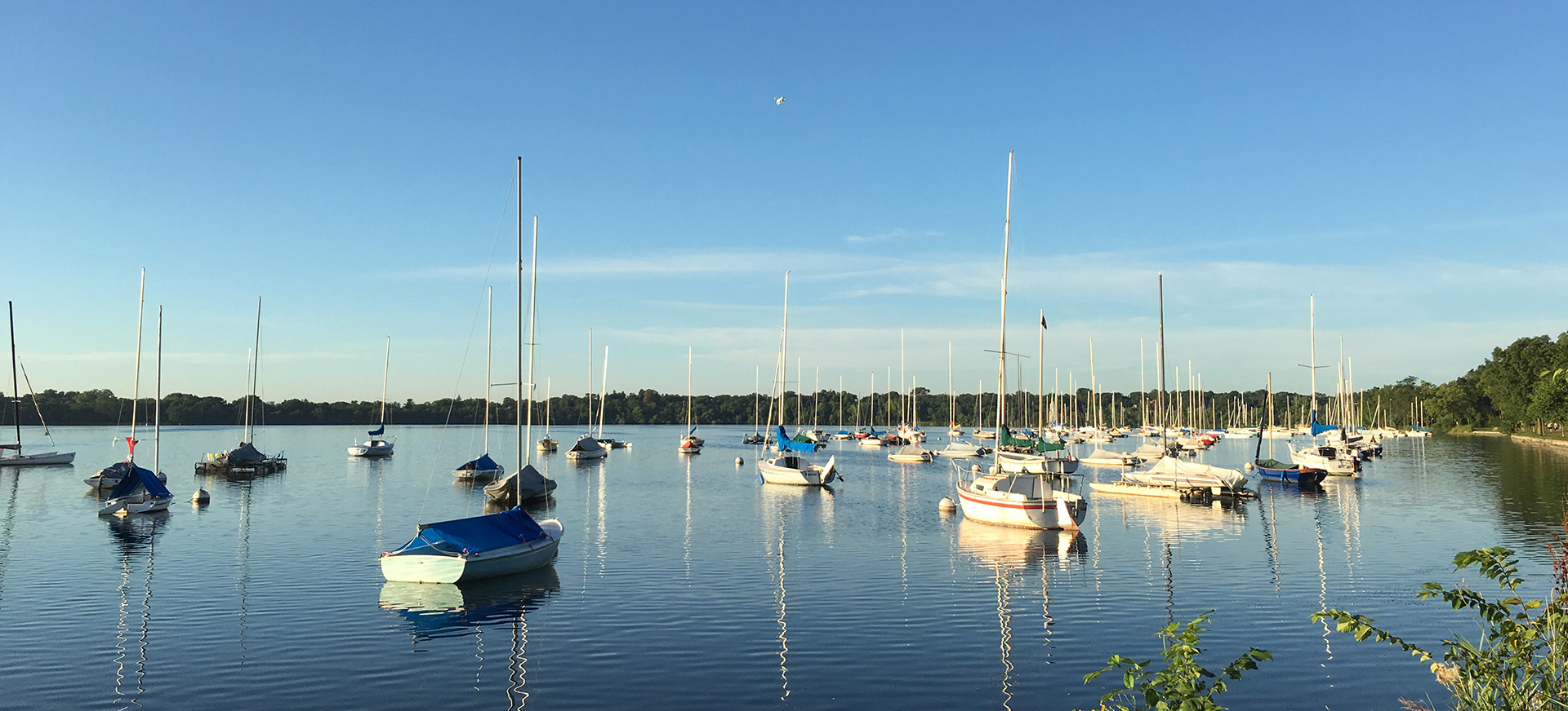 Our drone flying high above the sailboats docked at Lake Harriet.
