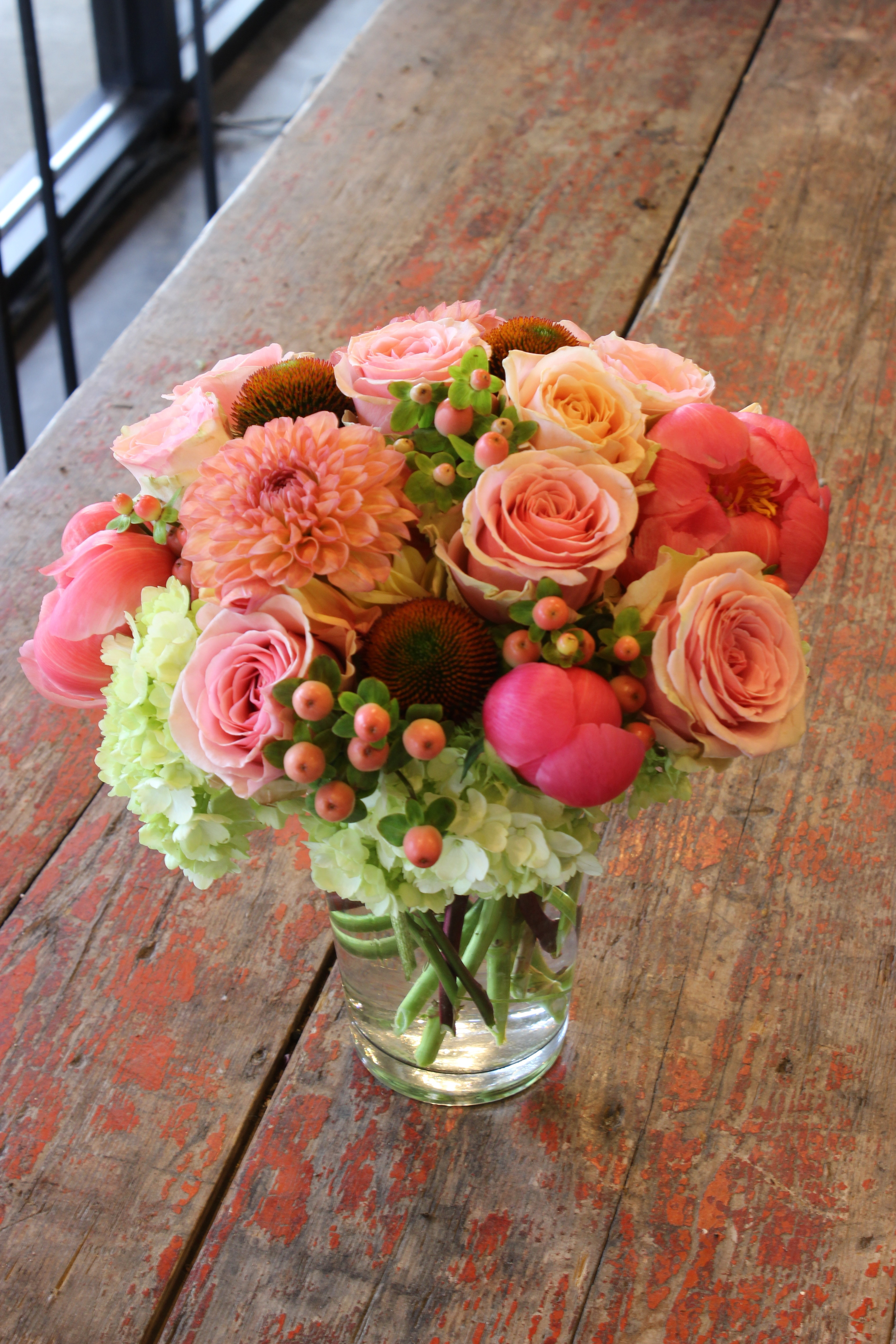 Low arrangement of assorted fresh flowers starting at $75.00