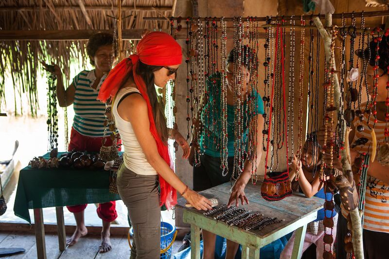 Exploring an Amazon community during a Delfin Amazon cruise excursion