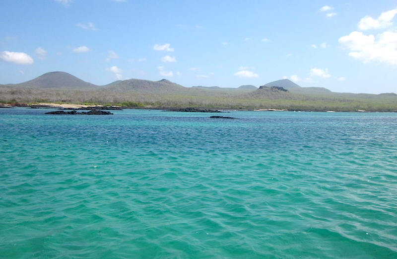 Beautiful teal-colored waters on Floreana Island