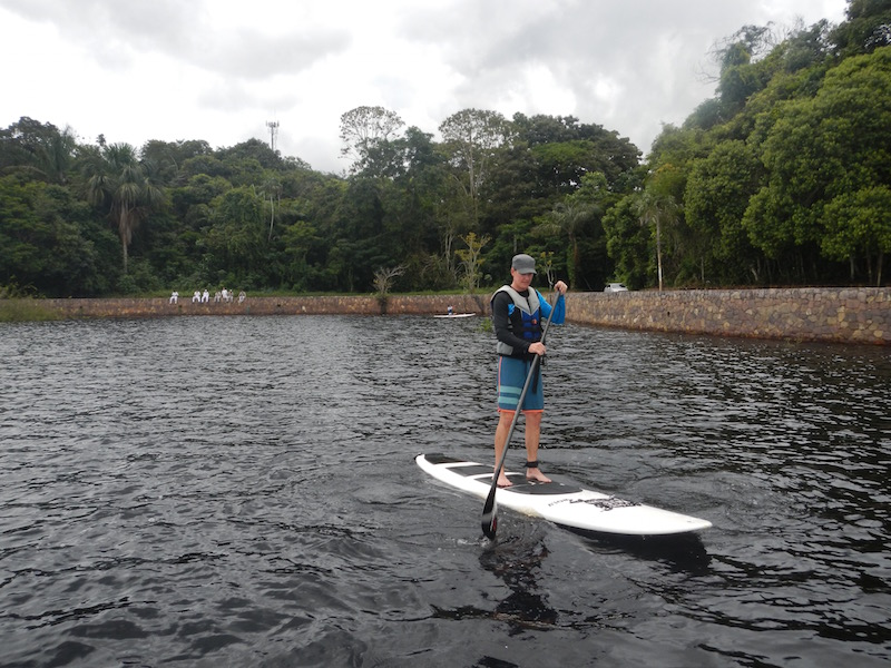 Enjoying Stand Up Paddling boarding on the Rio Negro, Brazil.