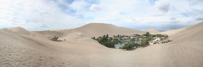 Huacachina Oasis surrounded by the desert.