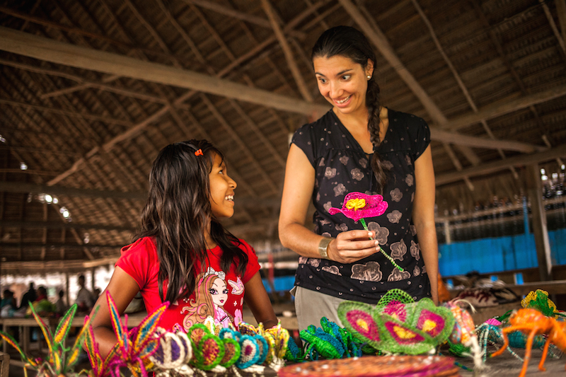 Buying souvenirs from Puerto Miguel, Peru while on a Delfin Amazon Cruise excursion.