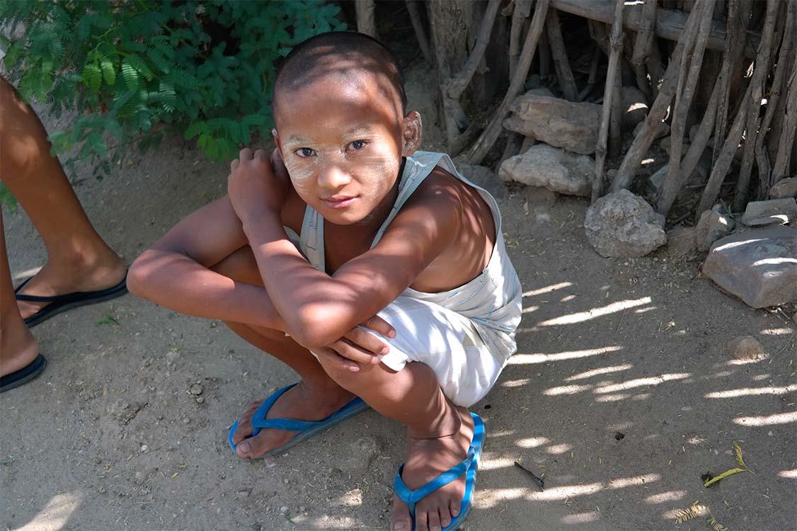 Village boy with Thanaka paste